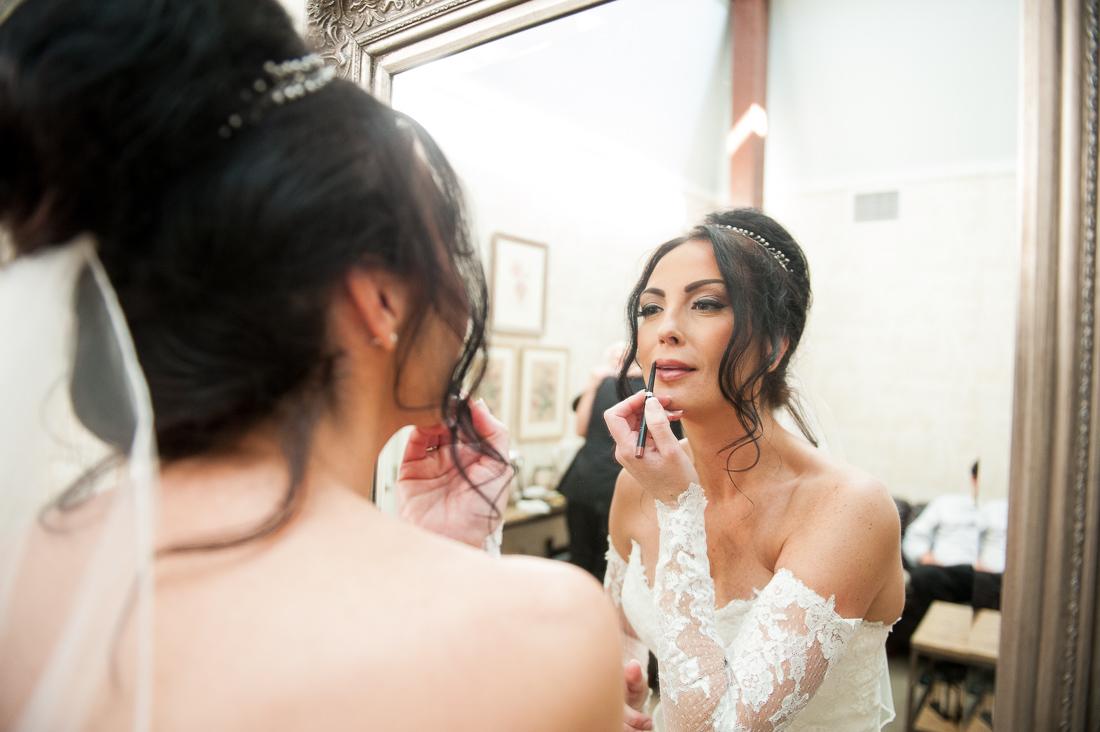 glamorous bride puts on lipstick
