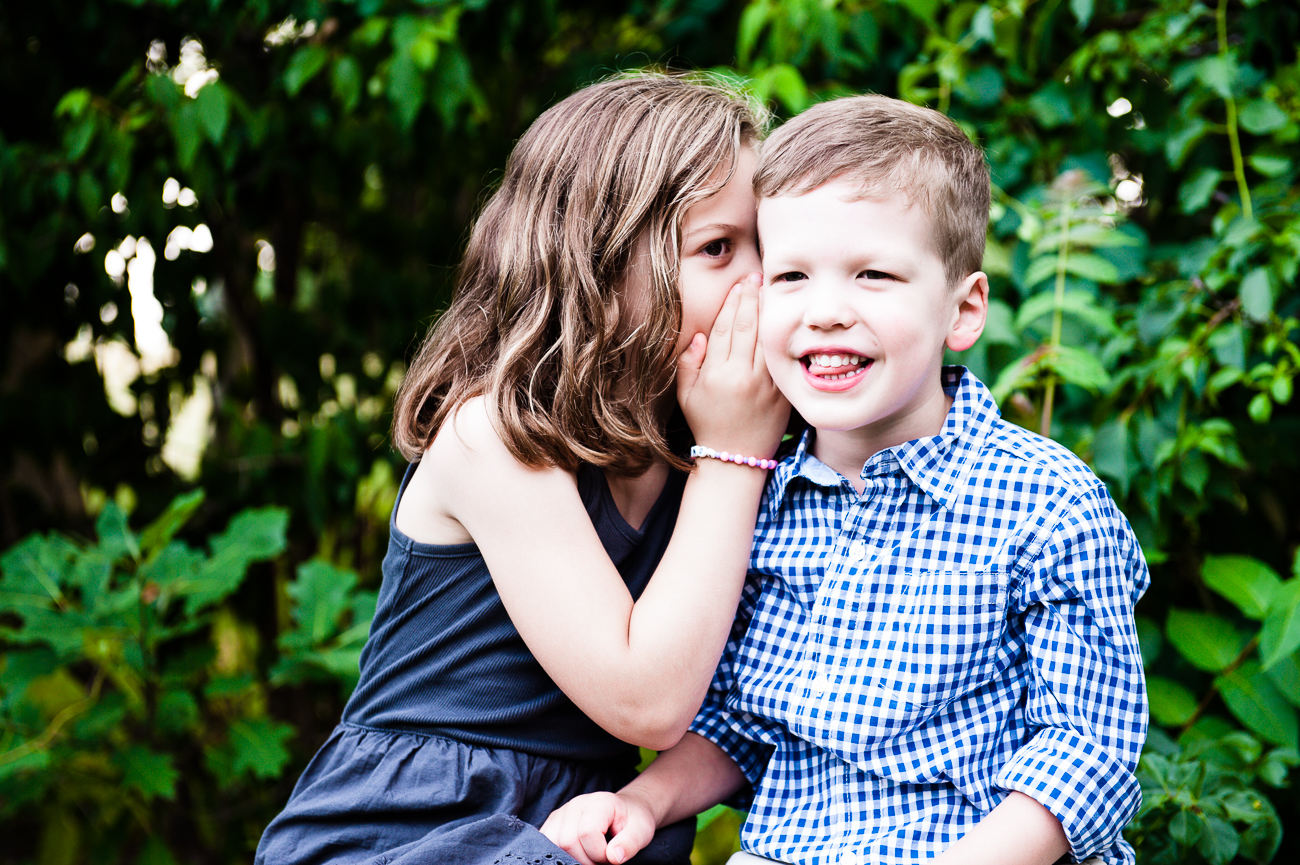siblings whispering