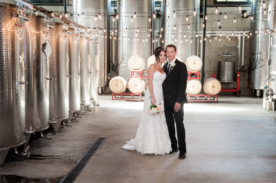 bride and groom portrait in wine distillary