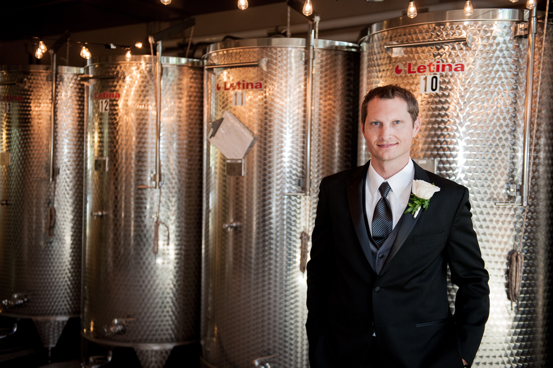 groom portrait in wine distillary